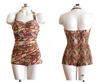 1950s halter top bathing suit in brown Hawaiian/tiki print