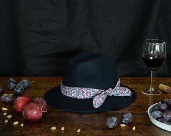 Navy Blue fedora hat decorated with a cotton scarf