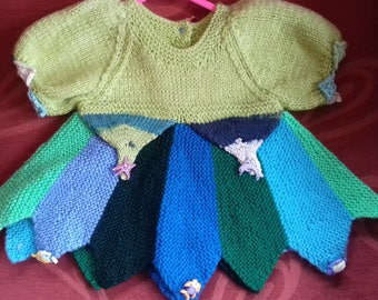 Hand knitted dress, knitted to fit a baby girl aged 0-3 months old