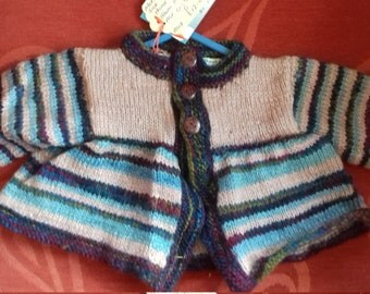Hand knitted cardigan,  knitted with home spun wool to fit a baby aged 0-3 months old