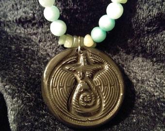 Ceramic Goddess Labyrinth pendant with snow quartz, aventurine, and dragonfly beads
