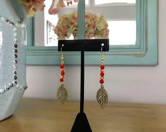 Beaded red leaf charm dangle earrings