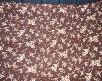 FABRIC HAS VERY PRETTY BROWN FLOWERS