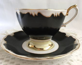 Royal Albert Crown China Tea Cup and Saucer, Black with Gold Trim, 1927-35