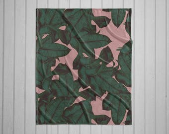 Tropical leaf green and pink plush throw blanket with white back