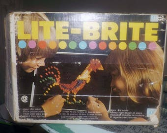 Vintage (c.1980s) Classic Hasbro Lite Brite toy.  Original box, 30 refills, large tub of colored pegs.  Tested and fully functioning!