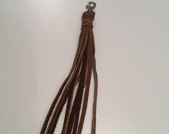 Tan leather Tassel Me purse clip