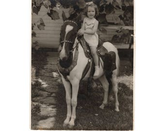 Yoing girl on a horse 8x10 photo