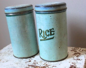 Two turquoise vintage tins with lids