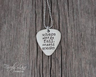 "hand stamped guitar pick necklace ""where words fail, music speaks"""