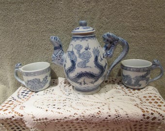 Chinese Dragon Teapot Hand Painted Blue White  Under Glazed Finish Qing Dynasty Porcelain  set of Dragon Handle Cups