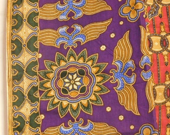 Two lengths of batik sarong fabric from Indonesia--vivid purple and yellow, and red and yellow