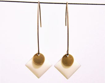 White enameled diamond earrings