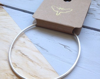 Fine silver bangle | Slim stacking bangle in a soft matt finish | 100% recycled silver | Eco-friendly jewellery | Recycled packaging.