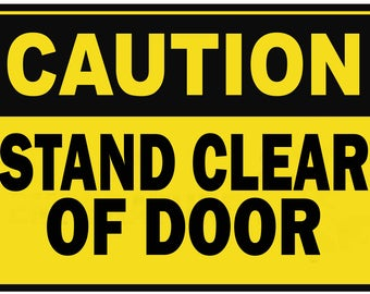 CAUTION Stand clear of door metal Sign