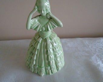 green ceramic crinoline lady figurine