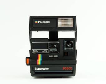POLAROID Supercolor 635CL Instant Film Camera - *Discount Impossible Project 600 Colour Instant film Pack offer with this Camera*