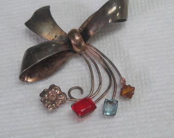 Sterling marked flower/bow Brooch