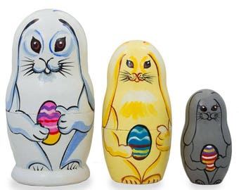 "4.25"" Set of 3 Bunnies with Easter Eggs Wooden Nesting Dolls"