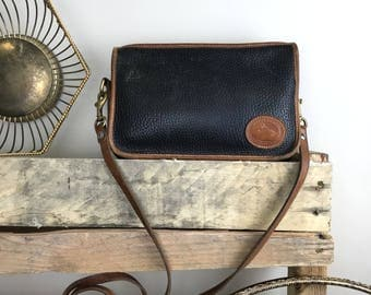 Vintage Dooney & Bourke Black Pebbled All Weather Leather Crossbody Purse with Brown Trim