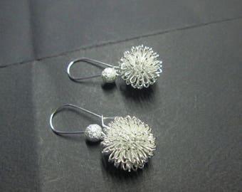 Earring in silver metal bead