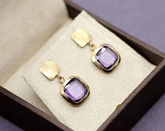 9k 375 solid gold earrings set with purple CZ crystals