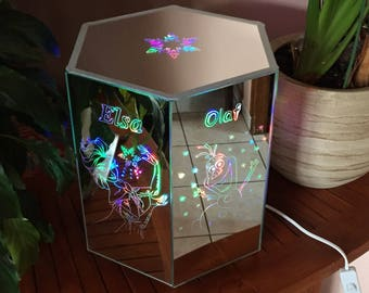 Hexagonal mirror lamp company and Elsa.