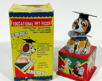 """1950's """"Educational Pet Pooch"""" tin toy by Shackman. Made in Japan."""