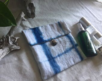 Indigo + natural dyed pouch with a metal concho button
