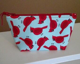Novelty print redbird pouch.