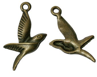 10 pendants in form of 2.6 cm Bronze coloured Metal swallow / bird / Animal