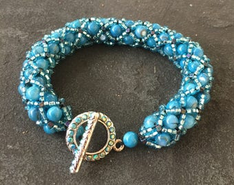 Turquoise filled netting beaded and woven bracelet