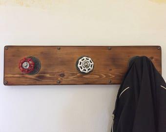 Wooden coat rack with knobs taps