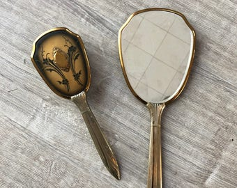 Antique hand mirror with brush