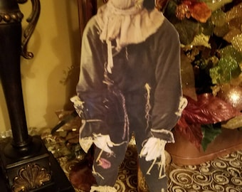 Scarecrow stand up figure on wood