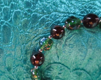 green flower with Garnet and Indian beads bracelet