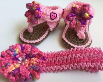 0-3 mos. hand crocheted flip flops with matching headband . Multi colored pink.