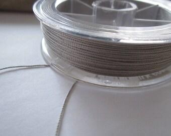 1 meter of 0.38 mm grey silk thread