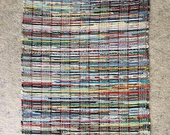 Multi-colored rag rug. 37 1-2 x25.   (15)