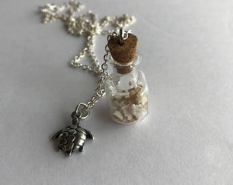 Coral in glass vial with sea turtle charm