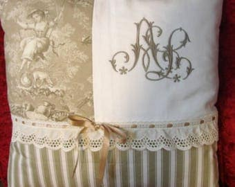 Pillow embroidered with a double Monogram a.