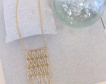 Gigi: Necklace gold beadwork.