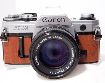 Vintage Canon AE-1 35mm camera with new custom leather cover and a super fast Canon FD 50 mm 1:1.4 lens.