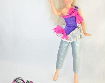 Vintage 80's Jem doll with accessories, clothes and shoes.