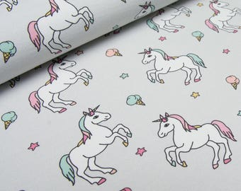Unicorns on grey french terry knit fabric