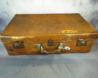 Vintage  Leather Suitcase with re enforced corners  possible late 1940