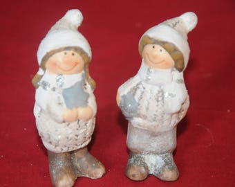Christmas decoration: children in winter in ceramic
