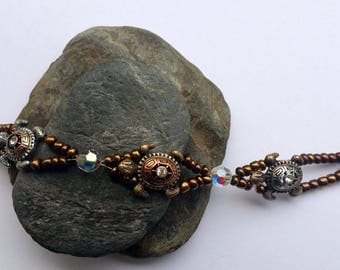 Sea turtle beaded bracelet, copper and AB crystal with fold over magnetic clasp