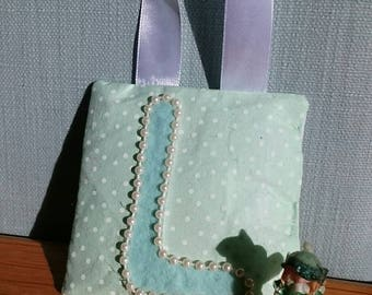 MINT spot tooth fairy pouch door-hanger with MINT letter, PEARL beaded border, and green diagonal pocket on reverse for tooth/coin.