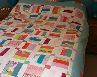 Handmade, patchworked bedspread/blanket with soft fleece backing.
